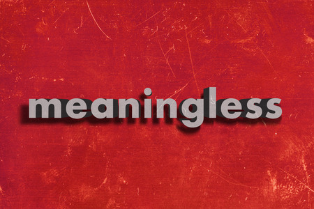 meaningless: gray word on red wall