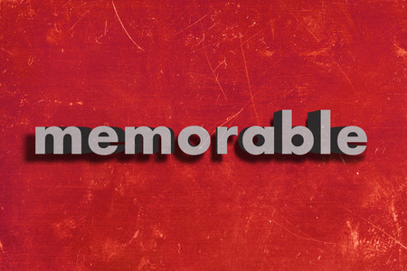 memorable: gray word on red wall