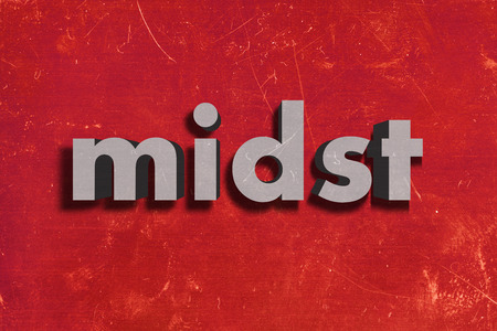 midst: gray word on red wall
