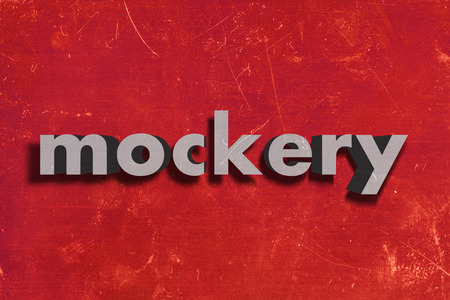 mockery: gray word on red wall