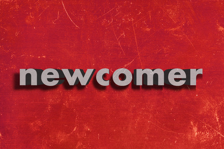 newcomer: gray word on red wall