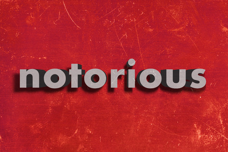 notorious: gray word on red wall