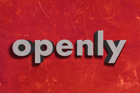 openly: gray word on red wall