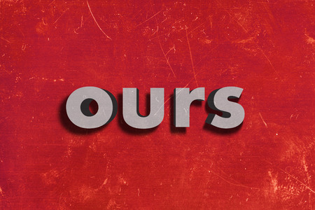 ours: gray word on red wall