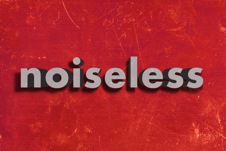 noiseless: gray word on red wall