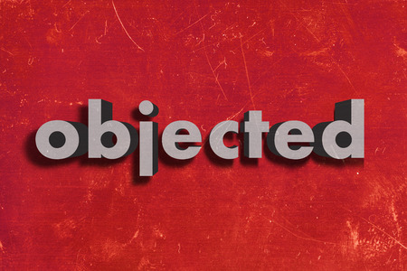 objected: gray word on red wall