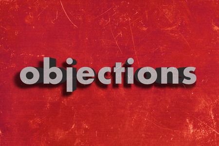 objections: gray word on red wall