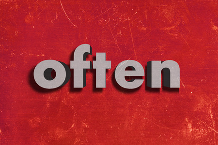 often: gray word on red wall