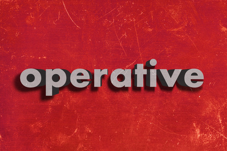 operative: gray word on red wall