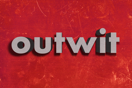 outwit: gray word on red wall