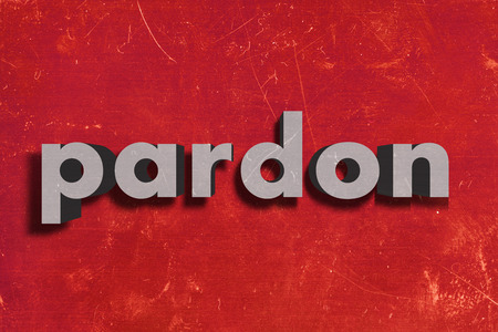 pardon: gray word on red wall