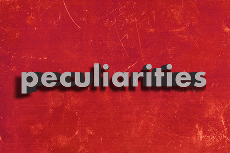 peculiarities: gray word on red wall