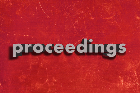 proceedings: gray word on red wall