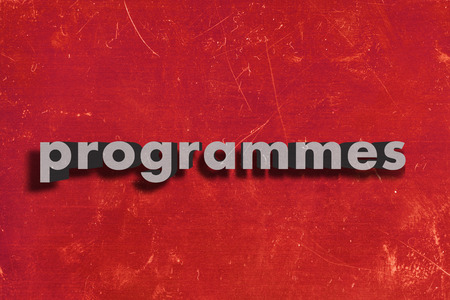 programmes: gray word on red wall