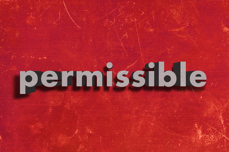 permissible: gray word on red wall