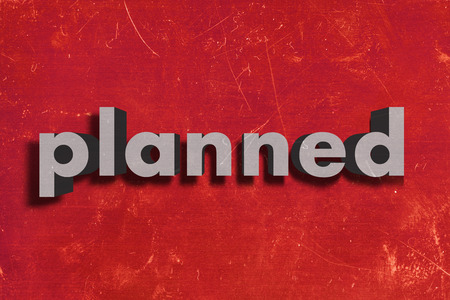 planned: gray word on red wall