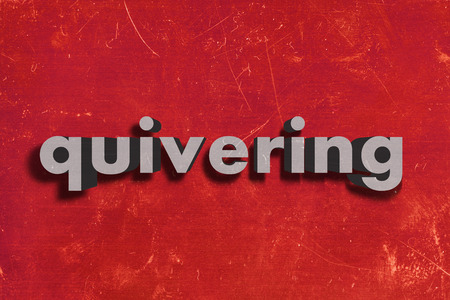 quivering: gray word on red wall