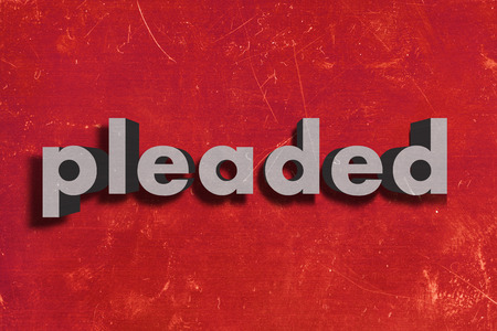 pleaded: gray word on red wall