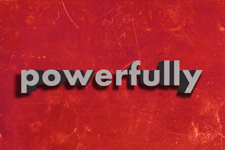 powerfully: gray word on red wall