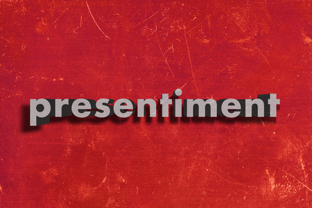 presentiment: gray word on red wall