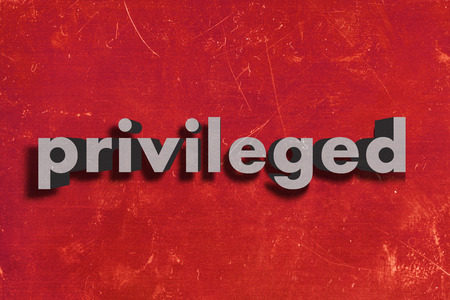 privileged: gray word on red wall