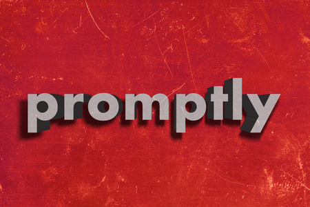 promptly: gray word on red wall