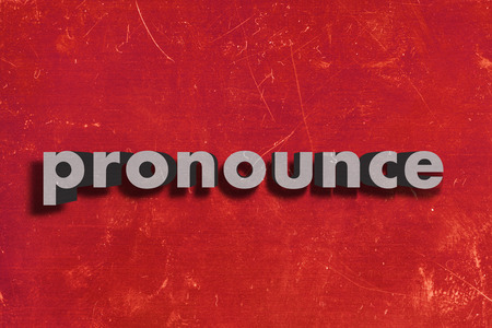 pronounce: gray word on red wall