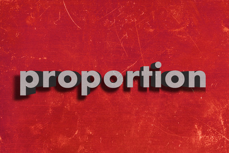 proportion: gray word on red wall