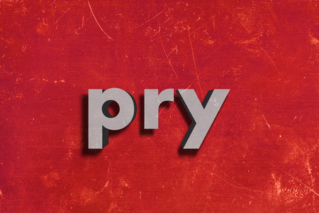 pry: gray word on red wall