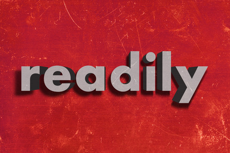 readily: gray word on red wall