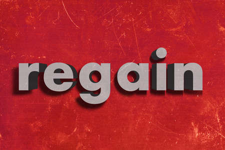 regain: gray word on red wall