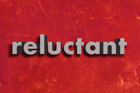 reluctant: gray word on red wall