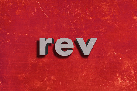 rev: gray word on red wall