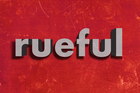 rueful: gray word on red wall