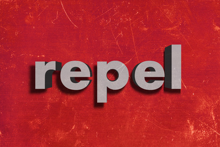 repel: gray word on red wall