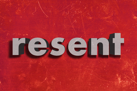 resent: gray word on red wall
