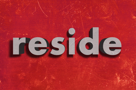 reside: gray word on red wall