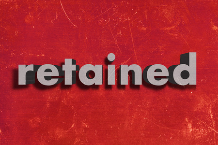 retained: gray word on red wall
