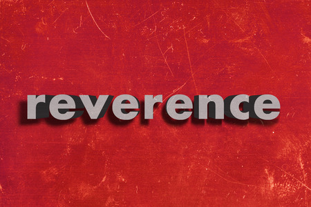reverence: gray word on red wall