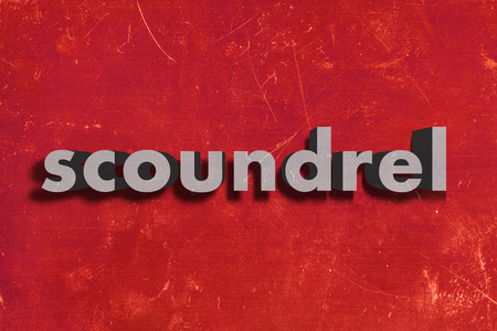 scoundrel: gray word on red wall