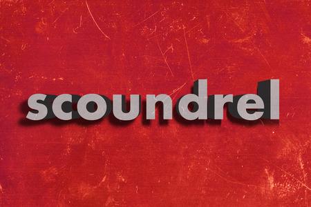 scoundrel: grigio parola su muro rosso