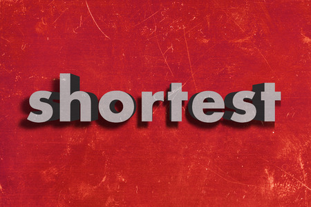 shortest: gray word on red wall