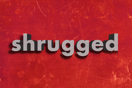 shrugged: gray word on red wall