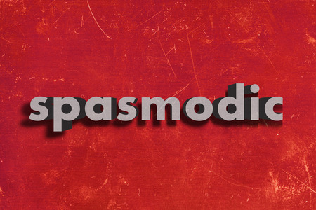 spasmodic: gray word on red wall