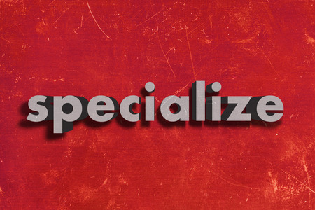 specialize: gray word on red wall