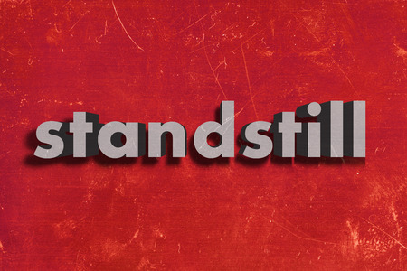 standstill: gray word on red wall