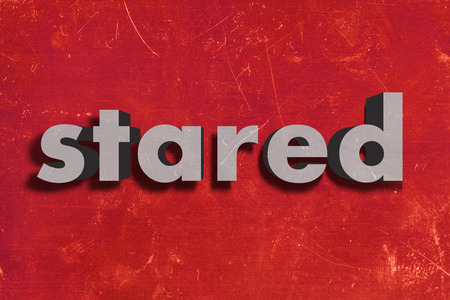 stared: gray word on red wall