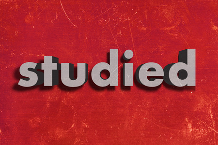 studied: gray word on red wall