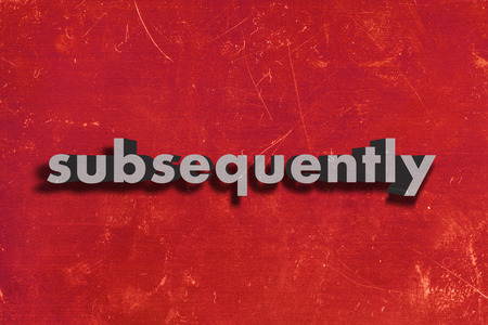 subsequently: gray word on red wall