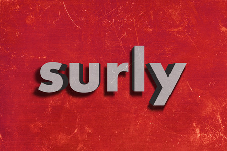 surly: gray word on red wall